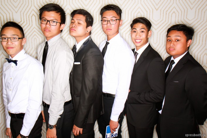 6 guys wearing formal in the photobooth