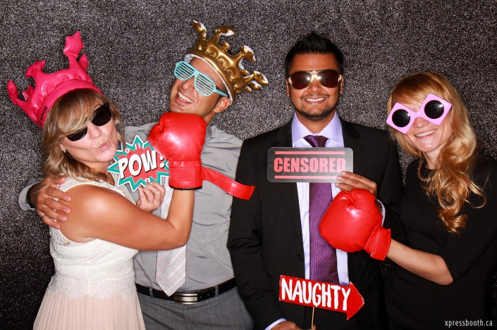Cool group using photo booth props: censored sign, boxing gloves, inflatable crown and pow sign