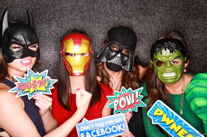 superhero masks with matching pow and pwned photobooth signs