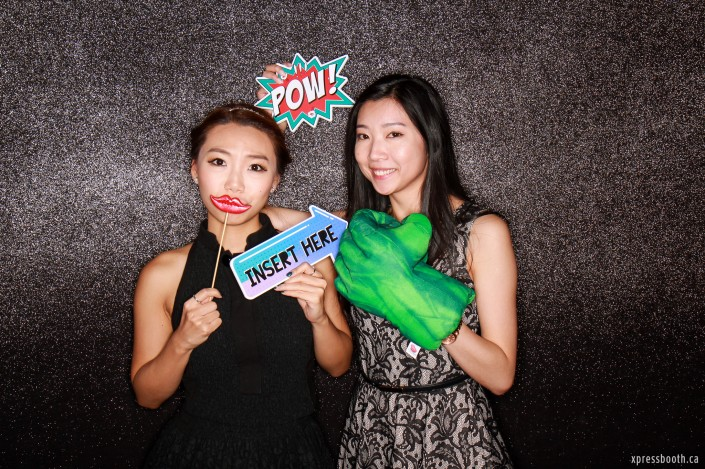 Two lovely ladies posing in front of the photobooth