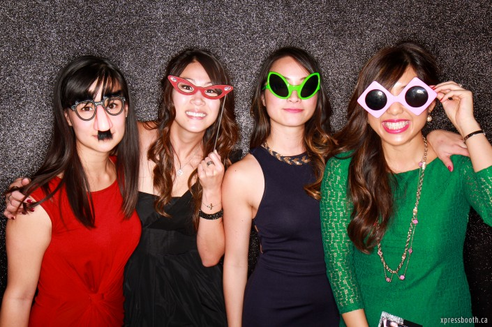 A group of ladies wearing funny glasses
