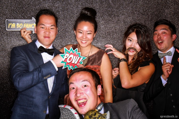 A group of friends doing funny poses in the photo booth