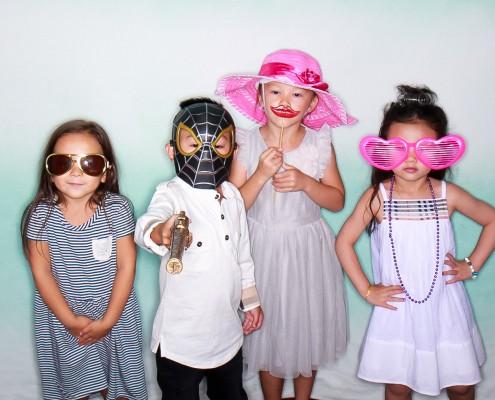 Kids using the photobooth