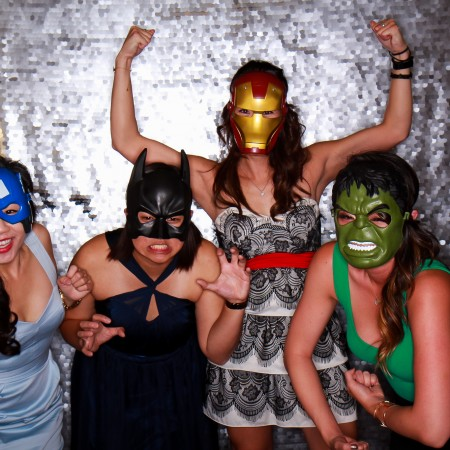 Fun with superhero masks! silver sequins backdrop photobooth