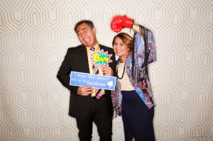 Funny couple with photobooth signs