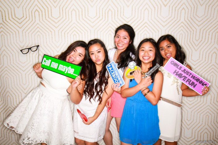Girlfriends holding up photo booth signs