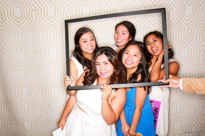 Girls holding a picture frame