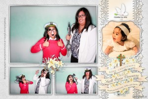 Two girls doing funny poses in the photo booth