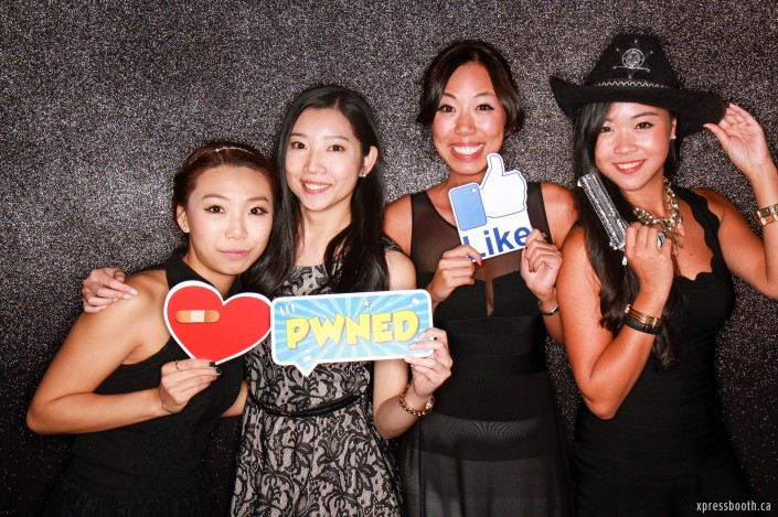 Ladies in the photo booth with cowboy get-up
