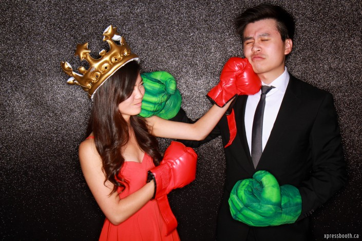 Funny couple doing boxing in the photobooth!