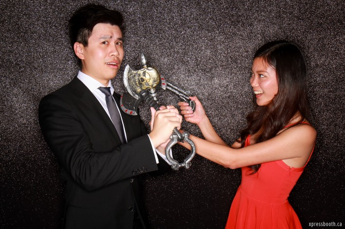 Cool couple with weapons in the photo booth