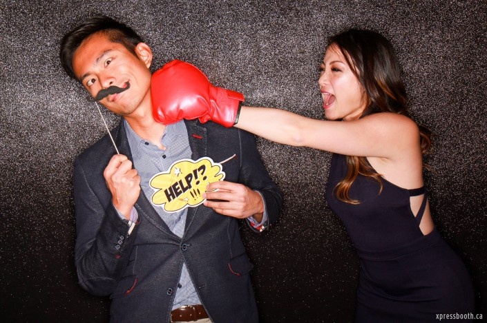 Guy getting punched by pretty girl holding up a help sign and moustache