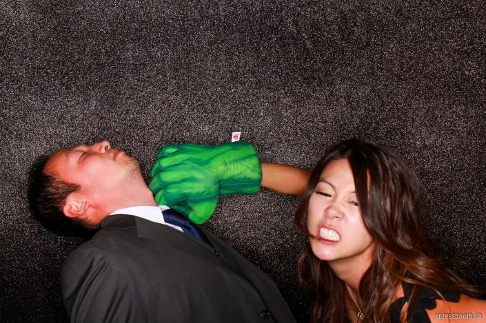 Cool shot of a girl pretending to be hulk punching a guy